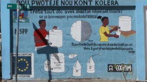A painting commissioned by Oxfam reminds people to purify their water before drinking it. Image by Meghan Dhaliwal. Haiti, 2012.